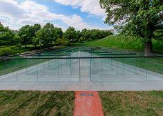 Glass panes form transparent labyrinth by Robert Morris