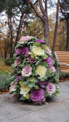 Fabulous Fall Containers • Great Tips and Ideas! Including, from 'home depot', this kale flower tower planter.