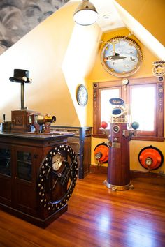 eclectic home office by Tess Fine Just a steam punk corner - with top hat and goggles, and analog pushed to the limit!