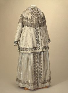 Late 19th-early 20th century silk, metal thread, fringe, plaited cord, and imitation pearls Maternity Dress, St Petersburg, Russia. Via State Museum of Ethnography of the Peoples of the USSR, Leningrad.