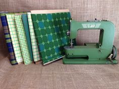 This vintage green elna grasshopper sewing machine is perfect to piece this vintage fabric into a new quilt