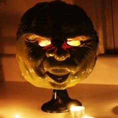 DIY Zombie lantern. Easy to make from a rubber mask and a pumpkin bucket.