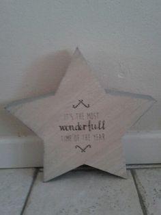 Dik houten ster met tekst