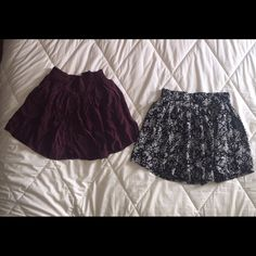 Black floral skirt & Maroon Skirt by Garage These two skirts are in PERFECT condition. Never worn! NWOT. The black skirt has a floral pattern. The maroon skirt has tiny white polka dots. Both have small buttons going down the middle of each. Size of both is Small. Both are measured 14 1/2 in. Long from the waist band to the bottom. Garage Skirts