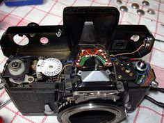 Nikkormat repair: After unscrewing one screw at the right side of the top plate the top can be removed.