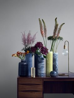 This series has one of the most beautiful color palettes I have seen all together in a while. I am smitten with all the moody tones without being too dark, sad or flat. #flowerstyling #moody #vases #ScandiStyle #flowervignette #EclecticTrendsBlog