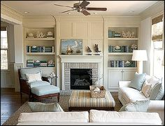 This is almost our living room! Except the colors are reversed and the sofa and love seat are pale teal.