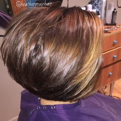 Stacked bob with layers and texture. Rich brown color and face framing highlights.
