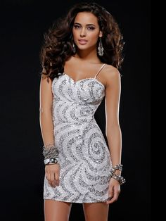 Short Spaghetti Strap Sequin Dress features a bold swirling pattern with Natural Waistline