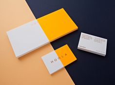 COLOR- peach, bright orange, dark blue (and turquoise?) Logo and business card with fluorescent ink and bronze foil designed by Two Times Elliott for women's swimwear brand Hoola