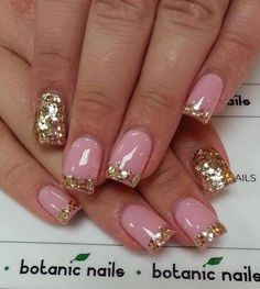 Gold themed glitter nail art design in French tip atop a clear base coat.