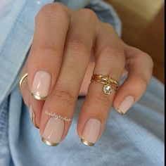 nude nails with a metallic french tip