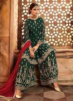 Dark Green And Red Embroidered Peplum Style Gharara Suit is specially designed to complement your alluring beauty. This suit set comprises a beautiful traditional zari and thread embroidered peplum. Bridal Mehndi Dresses, Mehendi Outfits, Pakistani Outfits, Bridal Lehenga, Fashion Designer, Indian Designer Wear, Designer Dresses, Sharara Designs, Indian Wedding Outfits