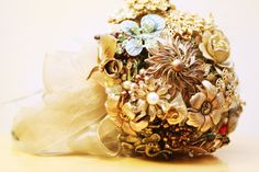 My wedding boquet made from  broaches and jewelry from relatives, friends, & thrift stores <3 <3 <3 Cried when I saw it! Look at it everyday on my dresser. :]