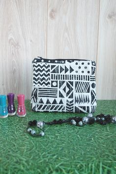 Women Make Up Bag https://etsy.me/2GmMpkB #etsy #airyfairybags #bagsandpurses #beige #womenbag #makeupbag #purse #cutehandbag #canvaspouch #cosmeticpouch #giftforher #zipperedpouch #smalltoiletrybag #africanstyle #geometricprint #ethnicbag #blackandwhite #africanmotif