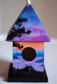 A mini birdhouse that I painted with acrylics :) $20.00 on Etsy!