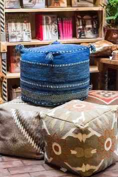 Textural Poufs in saturated colors will add extra seating or double as an occasional table. Or just put your feet up and relax in comfort!  http://rogersgardens.com/home-decor/