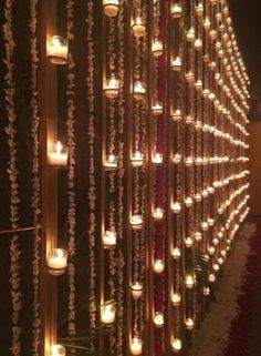 Wall with candles and floral nighttime decor - Best Picture For winter wedding ceremony decorations For Your Taste You are looking for something, and Desi Wedding Decor, Wedding Hall Decorations, Wedding Entrance, Wedding Mandap, Wedding Ceremony, Wedding Ideas, Wedding Venues, Wedding Walkway, Fence Decorations