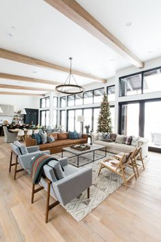 Open space, black window trim, wooden beams. ITS ALL PERFECT. A Very Mountain Home Christmas — STUDIO MCGEE