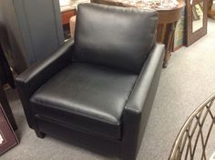 Easy Chair - Contemporary design easy chair in black leather.  Local manufacturer was overstocked so you get a deal.  Price $450.00   - http://takeitorleaveit.co/2013/10/19/easy-chair/