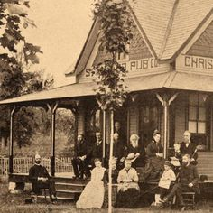 Men and women sitting on and in front of a porch in 1886. Preserving historic porches.