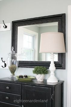 entry table inspiration: table, mirror, wall hooks (maybe brighter colors)