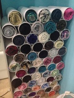 Innovative clutter free hijab storage idea. Made from plastic tubes.
