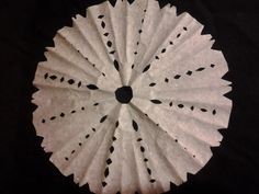 These Coffee Filter Snowflake Ornaments are one of the best Christmas crafts for kids!