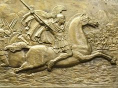 Relieve en bronce que representa a Alejandro Magno y su ejército en batalla. Shutterstock
