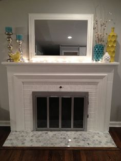 I like this mantel combo, would use a different color for the mirror frame.