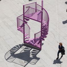 Tripod, Porto, Portugal : Tripod's chimerical form is a tribute to Porto's balconies – typical of the old town's 19th-century architecture – and the iconic, twisted staircases of the Lello Library bookstore and OMA's Casa da Musica. Previously displayed in the pictured pink/purple colour, it was re-configured in a summery yellow for the month of June.