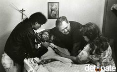 Published in November of 1990, this LIFE magazine photo changed the way America viewed AIDS. A son, dying of AIDS, is comforted by his father and family.