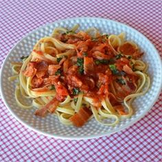 Amatriciana Pasta - A classic Italian pasta with a light tomato sauce. A bit of diced bacon makes it better than ever.