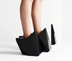 """cat potter """"crafts"""" geometric shoes from wood and corian.  Or she covers wooden boxes in leather and pretends they're shoes....your call."""
