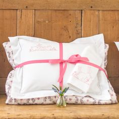 Pink bunnies ultimate baby bundle. A very special gift set including a pink bunnies printed cot quilt and a baby pillowcase and baby blanket hand embroidered with pink bunnies. Available with...