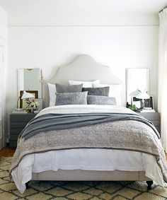 Caitlin and the team landed on a vintage Moroccan rug. The rug's warm ivory plays off the cleaner whites in the room, and its heritage lends a more grounded, authentic feel to the space.