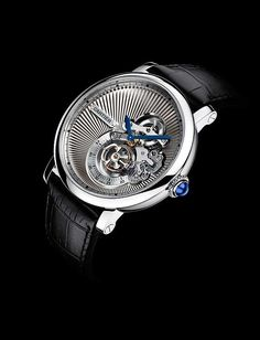The @cartier Rotonde de Cartier Reversed Tourbillon hours and minutes are indicated on two blued steel hands in the upper right area of the dial, while the tourbillon, the watch's heart, beats below the hands in the large aperture with a seconds scale. #cartier #watchtime #luxurywatch