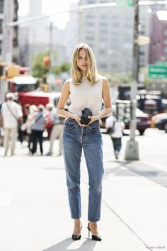 Elin Kling in New York looking polished in Levi's Vintage denim and a Issey Miyake pleated top.