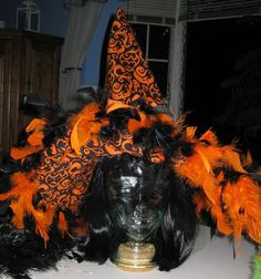 Orange and black #Halloween witch hat, two colour fabric with a feather trim.