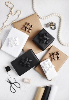 Monochrome Gift Wrapping DIY Paper Gift Bows - The Merrythought Paper Christmas Ornaments, Christmas Bows, Christmas Gift Wrapping, Christmas Gifts, Christmas Cocktails, Christmas Recipes, Handmade Christmas, Diy Holiday Gifts, Diy Gifts