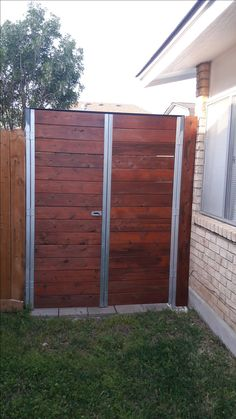 Privacy fence with swinging gate made from super struts for post and cedar decking boards