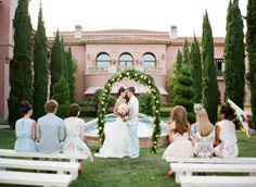 stunning wedding arch foliage and lemons- Find Your Wedding Venue with The Venue Report