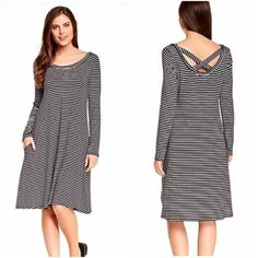"""Black white stripe strap cross open back dress Size S but could fit medium Adorable striped black and white midi dress! Features a strappy back detail with open back and criss cross straps in an x strap shape. Scoop Neck line, Long sleeves, horizontal stripes all over. Approximate length is 41"""", loose flowy fit like a sheath dress or shift dress, possibly a-line. ‼️MAKE AN OFFER‼️ Dresses Midi"""