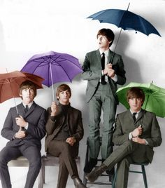 The Beatles and their umbrellas :3