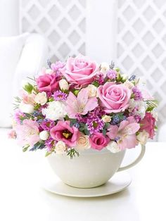 cool Gorgeous pink flowers in a giant teacup...