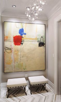 large painting + ottomans.  home decor and interior decorating ideas.  entryway.
