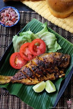Balinese Ikan Bakar Grilled to perfection with a moist & flaky flesh inside and a crispy charred skin on the outside. Fish Recipes, Seafood Recipes, Asian Recipes, Cooking Recipes, Ethnic Recipes, Fish Dishes, Seafood Dishes, Fish And Seafood, Seafood Menu