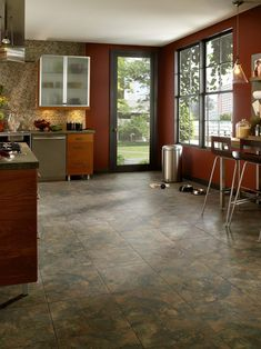 Add a stylish touch to a room by painting a diamond pattern onto a wood floor.