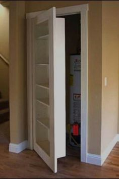 Hot water tank closet with bookcase door