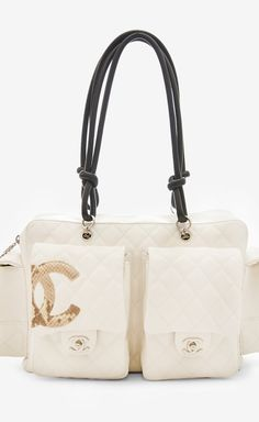 Chanel White And Black Shoulder Bag | VAUNTE Now THIS is embracing the black and white trend!